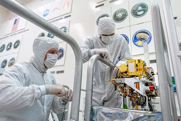 July 02, 2019 Engineers install the SuperCam instrument on Mars 2020's rover. This image was taken on June 25, 2019, in the Spacecraft Assembly Facility at NASA's Jet Propulsion Laboratory, Pasadena, California